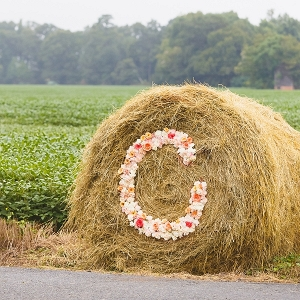 Floral monogram on hay bale