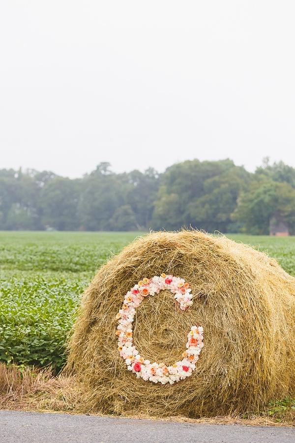 Floral monogram on hay bale