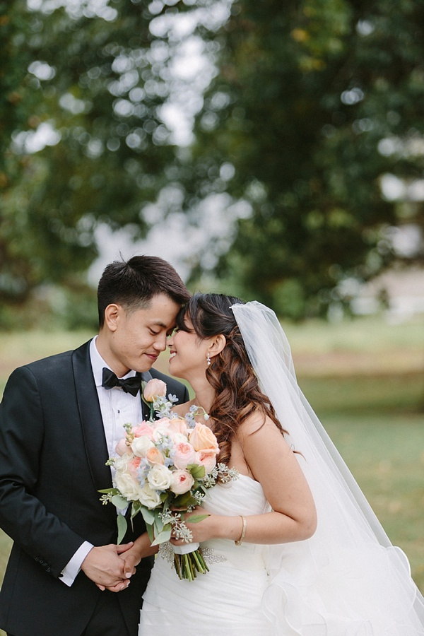 Filipino bride and groom with classic florals