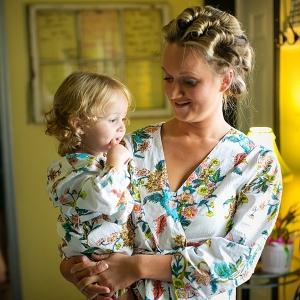 Mom and daughter wearing adorable matching floral robes