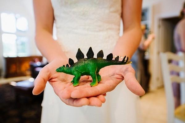 Bride holding dinosaur