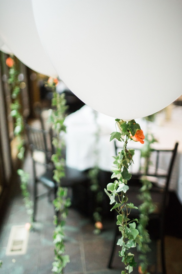 White balloons with ivy handles