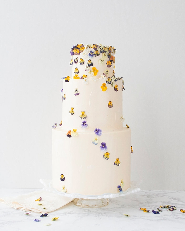 Dried pansy flowers on cake