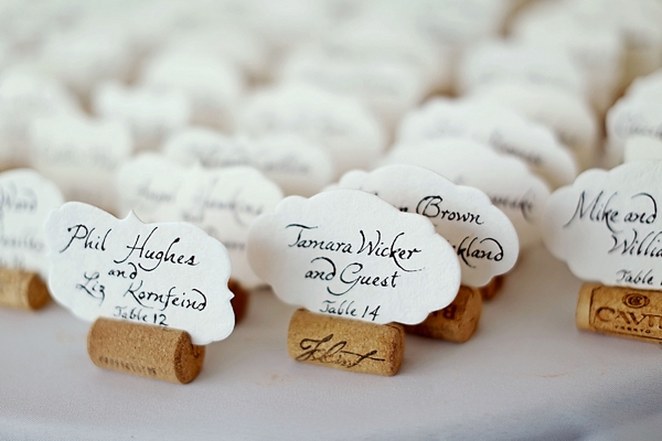 Scalloped calligraphy escort cards
