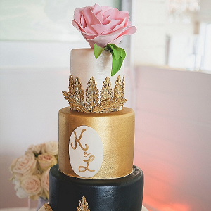 Metallic gold and black wedding cake
