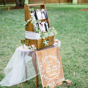 Wooden ladder and wedding sign