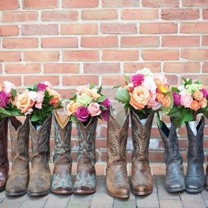 Bridesmaid bouquets in cowboy boots