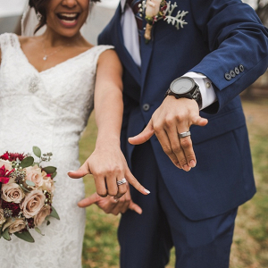 Bride and groom giving shaka hands