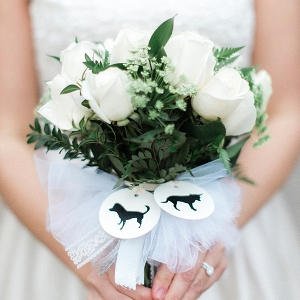 White wedding bouquet with dog silhouette bouquet charms