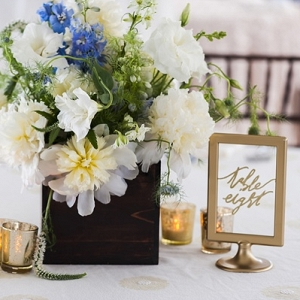 Flower centerpiece with gold frame table number