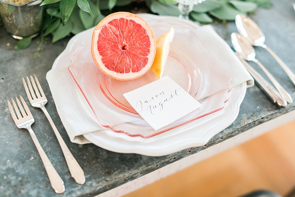 Grapefruit and calligraphy place setting