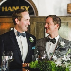 Two grooms in restaurant venue