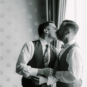 Two grooms share a kiss