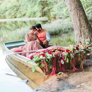 South Asian bride and groom in floral boat