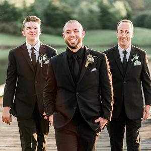 Groom in all black suit
