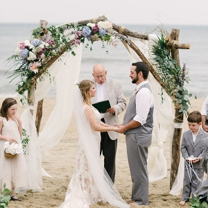 Beach wedding with ceremony arch