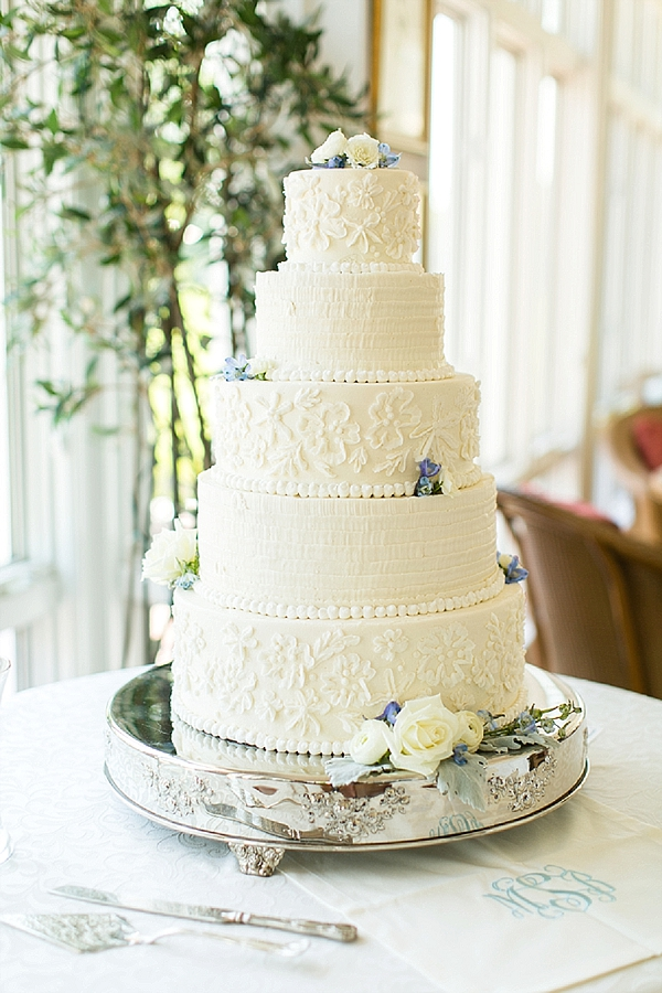 Tiered wedding cake with ruffles