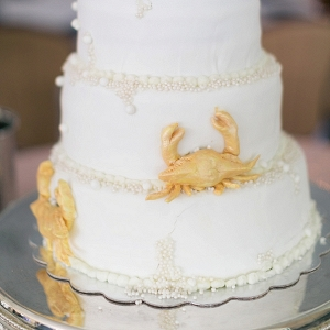 Adorable golden crab wedding cake