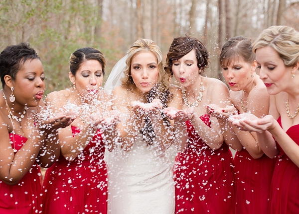 Red bridesmaid dresses and snow confetti