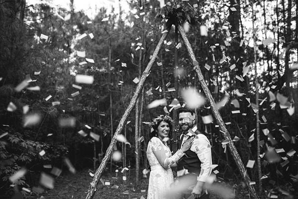 Confetti filled boho wedding ceremony