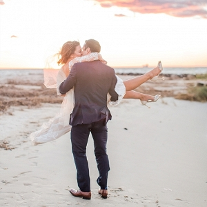 Romantic bride and groom sunset photo