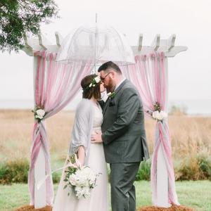 Rainy day wedding bride and groom