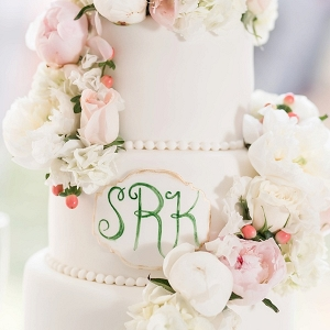 Pink and green monogram wedding cake