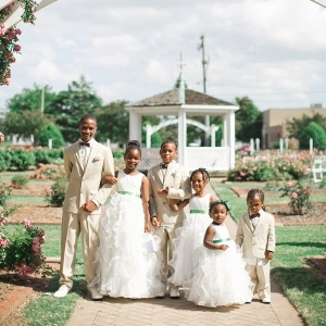 Flower girls and ring bearers in rose garden