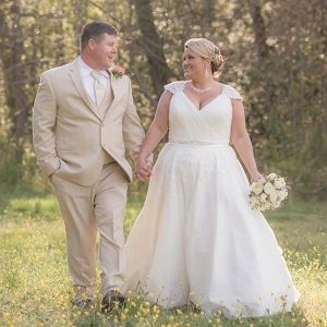 Country bride and groom in a meadow