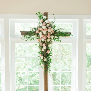 Floral covered ceremony cross