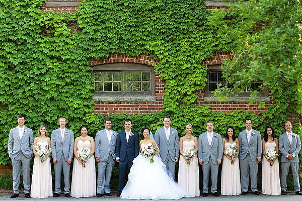 Ivy covered wall for wedding party photos
