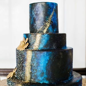 Navy blue and gold galaxy cake