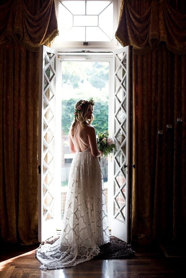Bride portrait in window