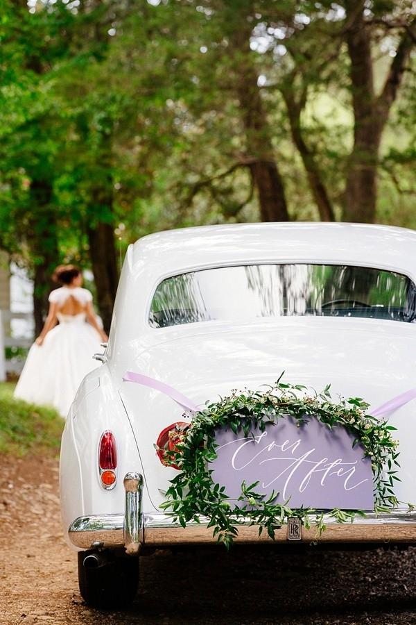 Vintage getaway car with wedding sign