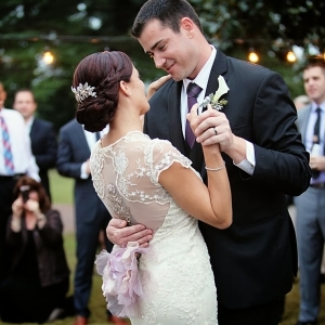 Claire Pettibone gown with purple flower
