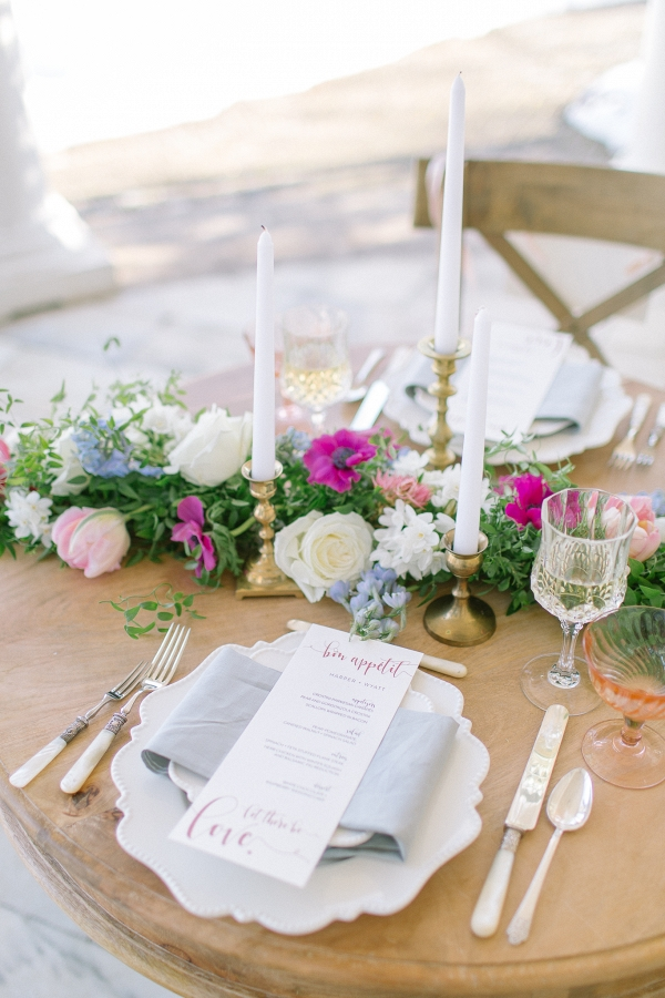 Taper candle and floral runner reception tables