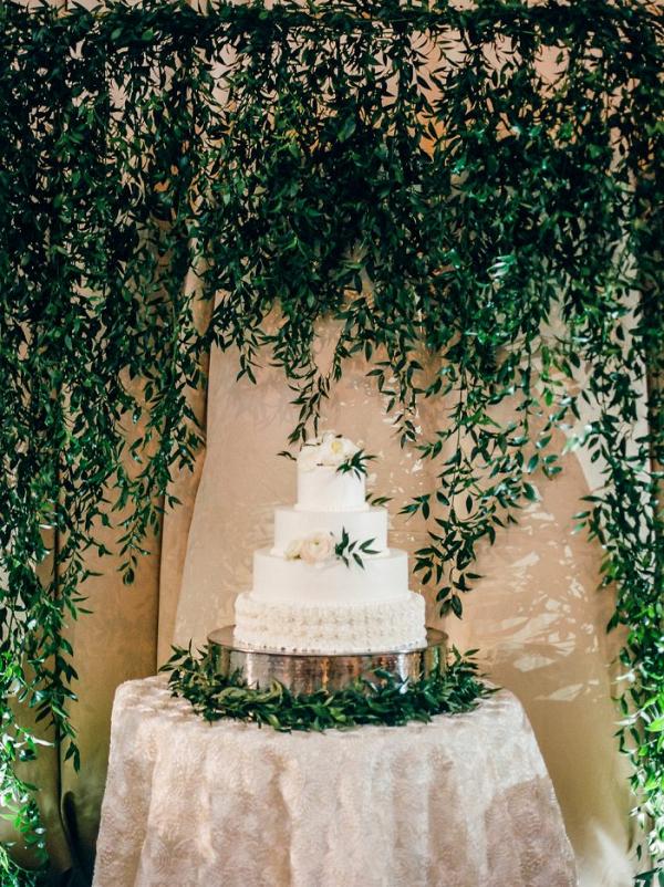 Beautiful Greenery Backdrop behind Textured Wedding Cake