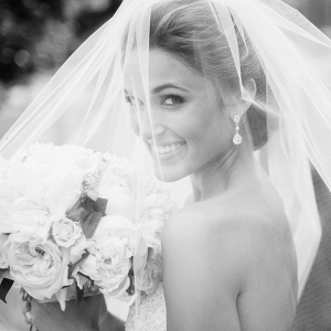 All white bridal bouquet and blusher bridal veil