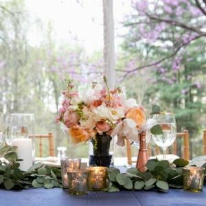 Peach Bouquet Centerpiece with Cobalt Blue Linens and Copper Accents
