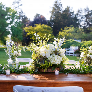 Textured Centerpiece and Greenery Runner on Farm Tables