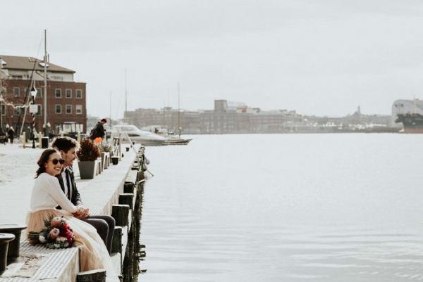 Bride and groom on harbor