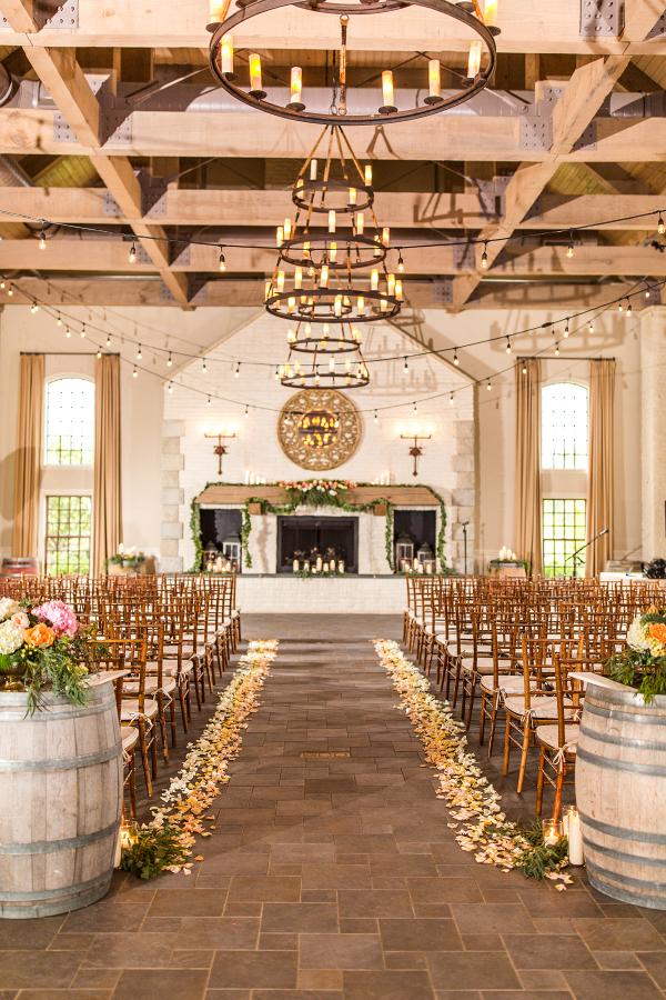 rustic chic indoor winery wedding ceremony
