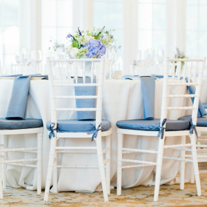 White Tables with Low Textured Centerpiece and Water Blue Accents