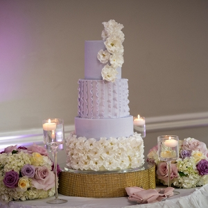 Purple ruffle fondant wedding cake with bling cake stand