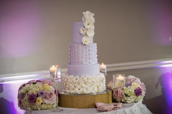 Purple ruffle fondant wedding cake with bling cake stand