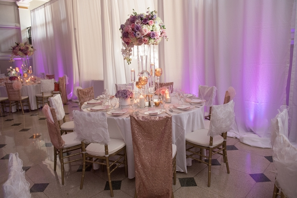 Orchid and rose tall lavender wedding centerpiece