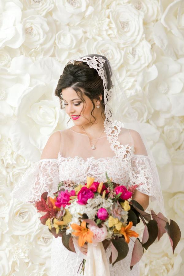 Mantilla veil and colorful bridal bouquet