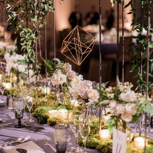 Lush greenery and geometric centerpiece