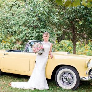 Bride with yellow vintage car