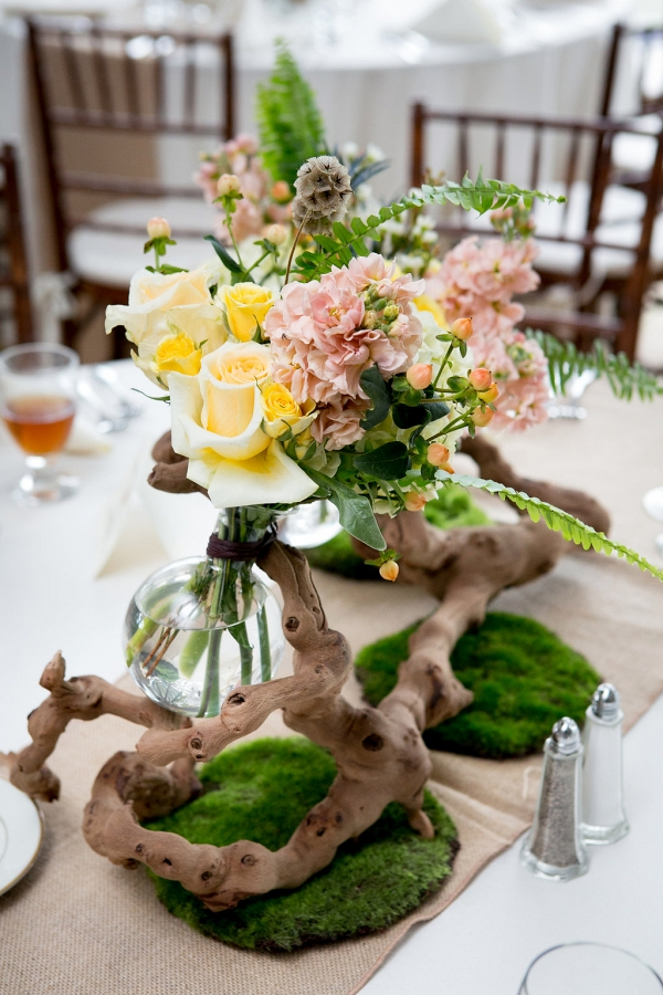 driftwood centerpiece with pastel floral accents